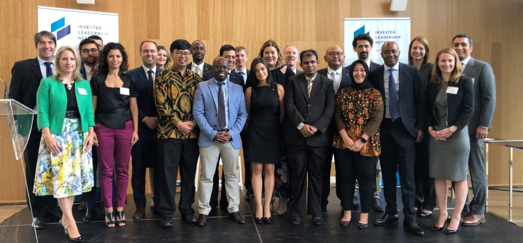 Investment Leadership Network organization members congratulating 13 new graduates of the sustainable infrastructure program.